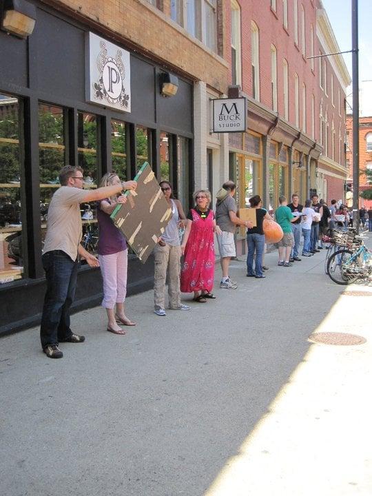 parade Day 27: UICA Human Chain Moving Parade