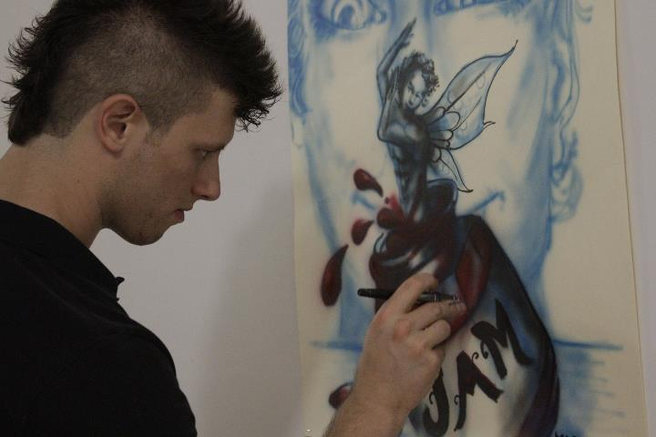 Local artist Marco working on his airbrushing piece courtesy of Josh Beebe Day 175: SPACE