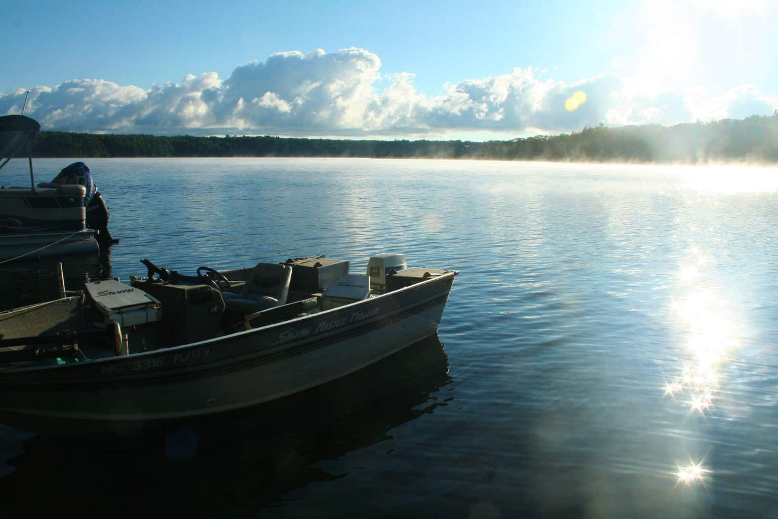 Boating Oscoda scaled Why you should live Michigan by camping Michigan