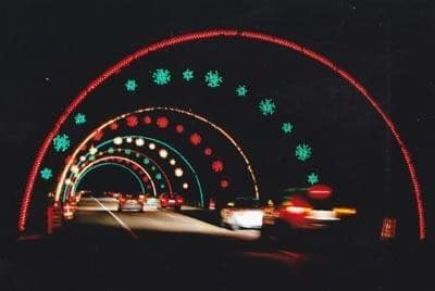 Cars pass under the holiday lights along the four-mile stretch at the Wayne County Lightfest. Photo courtesy of Dearborn Press and Guide.