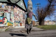 Cave demonstrates a Soundsuit near the African Bead Museum on Grand River in Detroit. Photo by Bruno Vanzieleghem (Flickr: @Bruno_VZ)