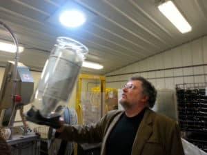 Larry Mawby shows off a fancy wine keg.