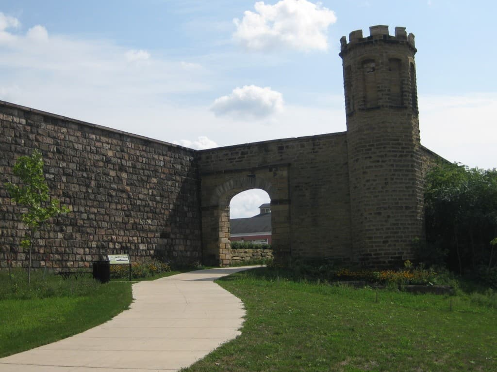 Armory Arts Walk through the old prison wall | Photo Courtesy of Experience Jackson - Awesome Mitten