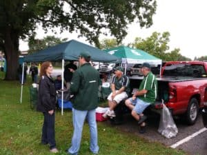 A few canopy tents, a portable grill, and friends make the perfect tailgate.