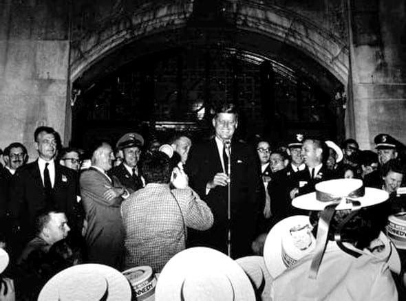 President John F. Kennedy delivers the Peace Corps speech on the steps of the Michigan Union. Photo courtesy of UM Bentley Historical Library)