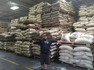 Barista, Alex Fields, picking up an import coffee order. Photo courtesy of Contrast Coffee Co.