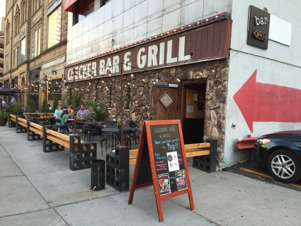 Take a minute to relax with a burger and a beer in the sun without leaving Downtown Detroit, as Checker Bar is just a block from Campus Martius. Photo courtesy of Chick in the Mitt
