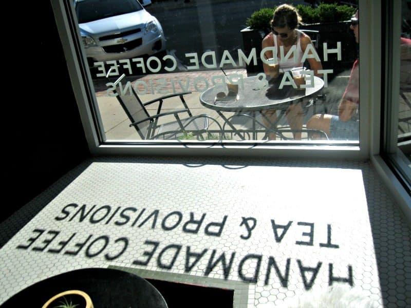 Window reflection at Harless & Hugh. Photo Courtesy of Margaret Clegg