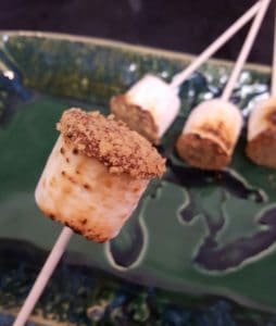 Toasted marshmallows dipped in chocolate and crushed graham crackers make a bite-size treat. Photo courtesy of Jackie Mitchell.