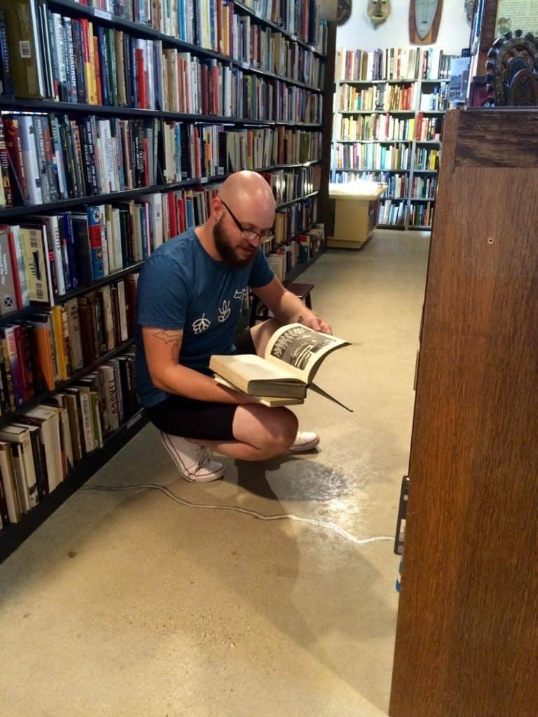 Jonathon Arntson enjoying the selection at Totem Books. Photo courtesy of Joanna Dueweke.