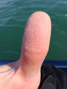 A fisher gives a thumbs-up with a Bass Thumb. Photo by Michele Eichstead