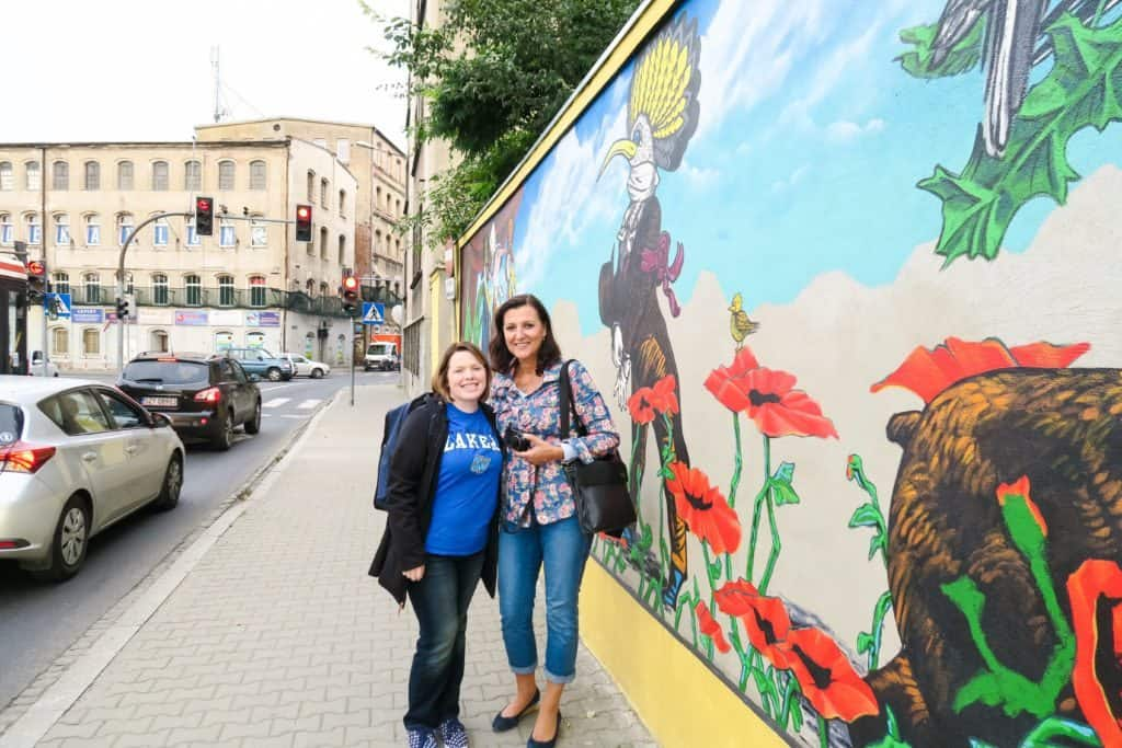 My tour guide, Ewa Kozak, and me in front of the mural painted by a Grand Valley State University professor and two alumni. Photo courtesy of Jennifer Polasek.