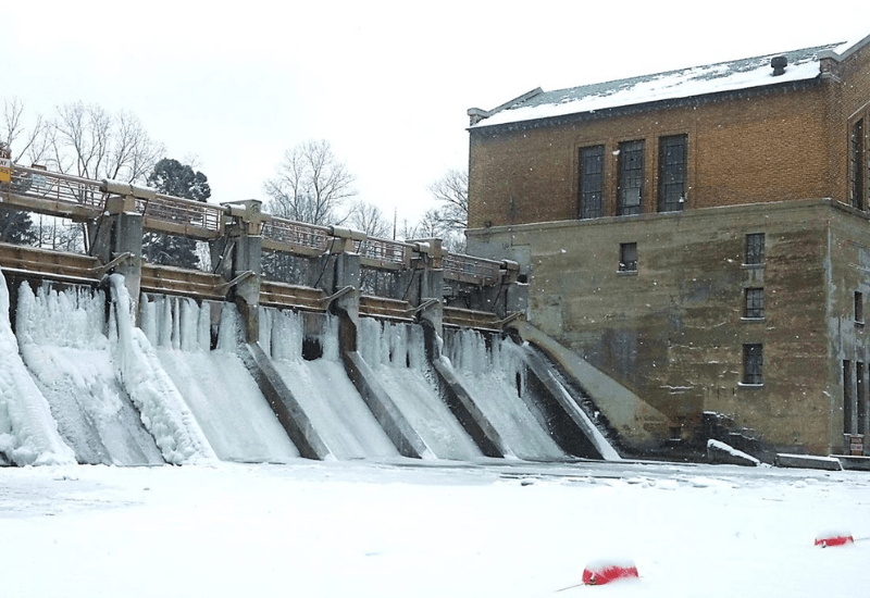 barton dam frozen waterfalls in michigan
