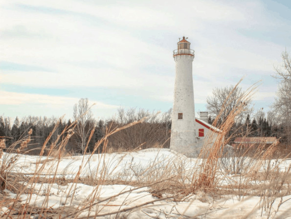 winter lighthouse in Michigan:Sturgeon Point Light