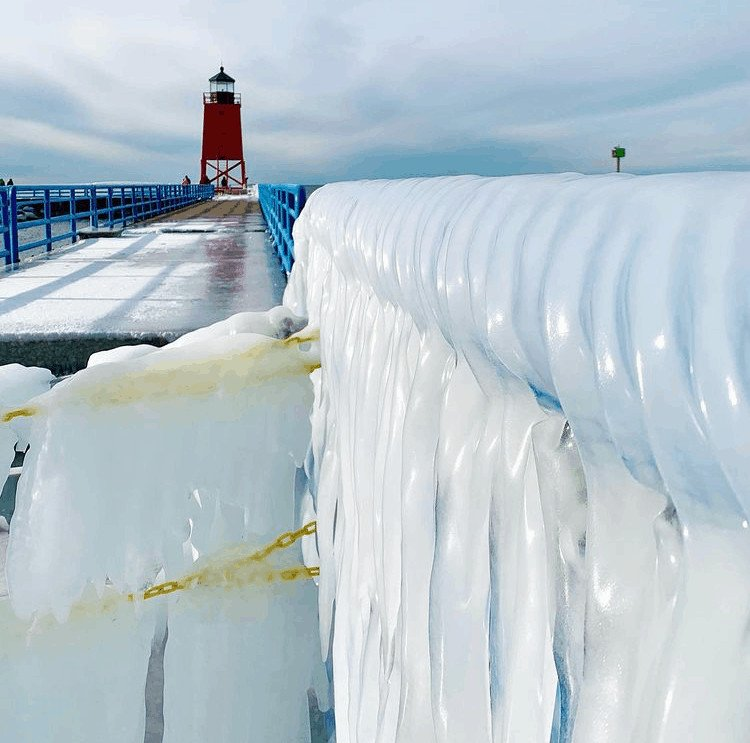 winter lighthouse in Michigan:Charlevoix South Pier Light Station