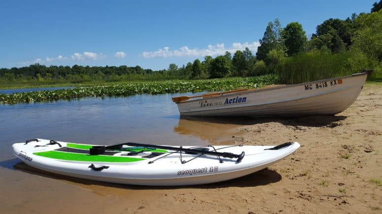 Ronora Lodge Paddle board and rowboat 8 Summer Bucket List Ideas in Southwest Michigan
