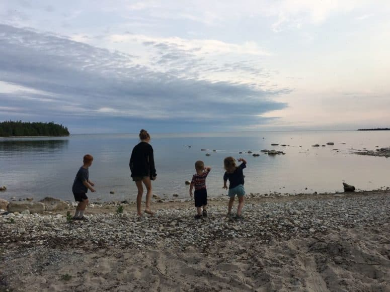skipping rocks in Lake Huron LCI Just 4 Days to Explore the Upper Peninsula this Summer? Here's What We Did. #MittenTrip