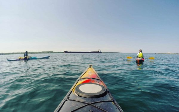 Kayaking on the St. Marys River in Sault Ste. Marie, Michigan.